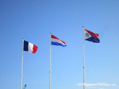 Le bandiere francese, olandese e dell'isola